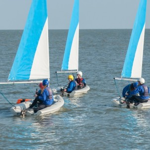 Dinghy sailing on the sea