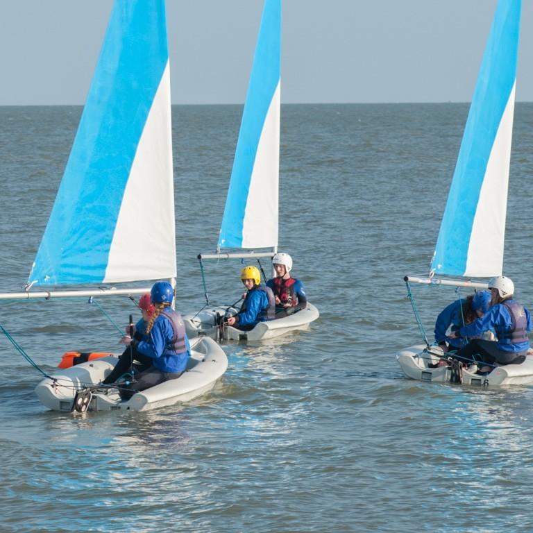 Dinghy sailing on the sea