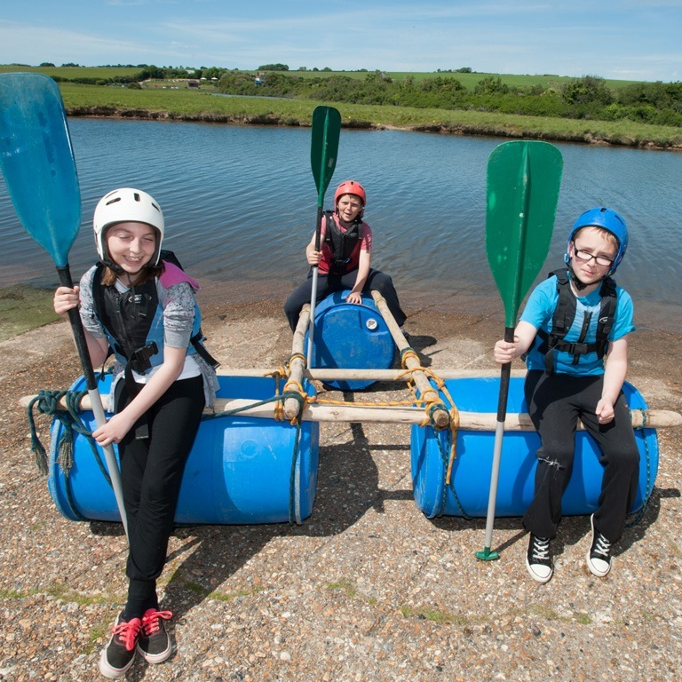 Kids aboard their raft