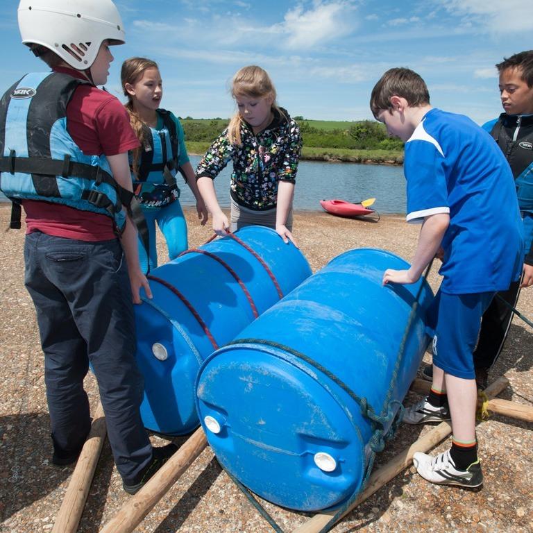 Kids building a raft