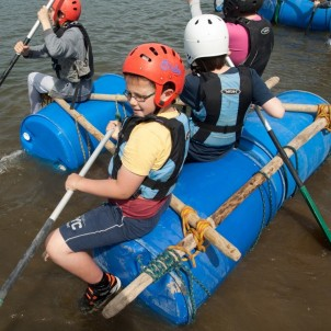 Kids setting sail on their raft